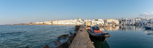 Naoussa village and harbor at sunset - Aegean Sea - Paros Cyclades island - Greece. View of Naoussa village and harbor at sunset - Aegean Sea - Paros Cyclades royalty free stock image