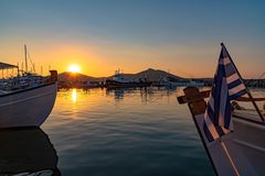 Naoussa village and harbor at sunset - Aegean Sea - Paros Cyclades island - Greece. View of Naoussa village and harbor at sunset - Aegean Sea - Paros Cyclades royalty free stock images