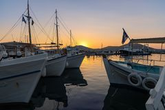 Naoussa village and harbor at sunset - Aegean Sea - Paros Cyclades island - Greece. View of Naoussa village and harbor at sunset - Aegean Sea - Paros Cyclades stock image
