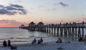 Pier jetty at sunset in Naples, forida, usa. A view in NAPLES, UNITED STATES, NOVEMBER 30, 2017 : pier jetty at sunset , november 30, 2017 in Naples, Florida Stock Image