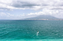 View of Naples and Vesuvius from Sorrento. With Windsurfer Stock Photography