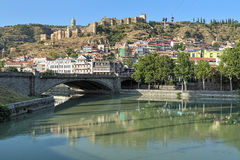 View of Narikala Fortress in Tbilisi, Georgia. View of Narikala Fortress from the shore of Kura River near the Metekhi Bridge in Tbilisi, Georgia Stock Photography