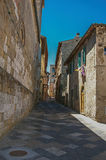View of narrow alley with old buildings and belfry in Colle di Val d`Elsa. A graceful village with its historic center preserved and known by its crystal Stock Images