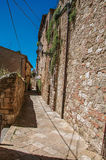 View of narrow alley with old buildings and lamps in Colle di Val d`Elsa. A graceful village with its historic center preserved and known by its crystal Stock Images