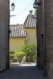 View through a narrow alley, old town in southern Europe Royalty Free Stock Images