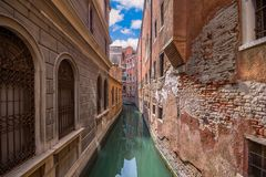 View of narrow canal in Venice. Architecture and landmarks of Venice. Italy. Narrow canal street royalty free stock photo
