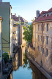View of the narrow channel among houses in Prague Royalty Free Stock Photos
