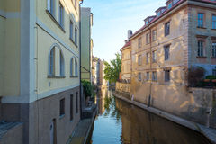 View of the narrow channel among houses in Prague Stock Photo