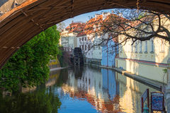 View of the narrow channel among houses in Prague in sunny sprin Stock Images