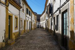 View of a narrow cobblestone street in the village of Nisa, Alentejo, Portugal royalty free stock photos