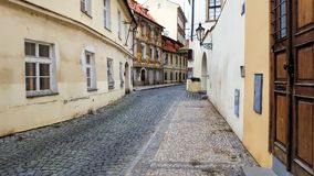 View on the narrow cobblestoned street in Prague, Czech Republic stock image