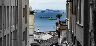 View through a narrow lane of the old town to the Bosporus with many ships stock photos