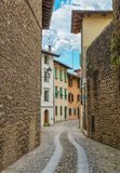 View through narrow, medieval Italian street, Italy Stock Images
