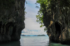 View Through a Narrow Passage Between the Karst Cliffs Stock Photo