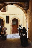 View of the narrow paved street and motorcycles in the traditional Greek town royalty free stock photos