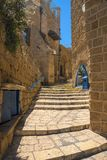 View of a narrow stone street through a staircase in the old city of Jaffa, with the old houses still. View of a narrow stone street through a staircase in the royalty free stock photo
