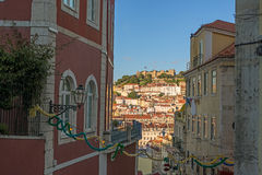 View of a narrow street in the city Lisbon downtown during twili Stock Image