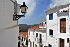 View from narrow street in Frigiliana, Spanish white village Andalusia Royalty Free Stock Images