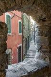 View of narrow street through an old stone window royalty free stock photos