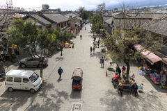 View of a narrow street and tourists in the old town of Dali in Yunnan, the ancient kingdom of Nanzhao Stock Image