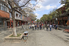 View of a narrow street and tourists in the old town of Dali in Yunnan, the ancient kingdom of Nanzhao Stock Photos