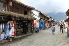 View of a narrow street and tourists in the old town of Dali in Yunnan, the ancient kingdom of Nanzhao Stock Images