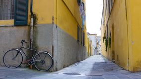 A view of a narrow yellow street of Pisa royalty free stock photos