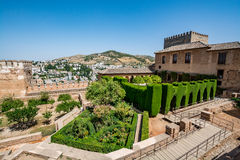 View of the Nasrid Palaces Palacios Nazaríes and gardens in front of them in Alhambra. Granada on a beautiful day, Spain Stock Photography