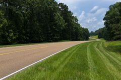 View of the Natchez Trace Parkway in the State of Mississippi, USA. View of the Natchez Trace Parkway in Mississippi; Concept for travel in America and road trip stock photo