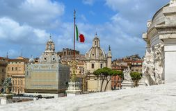 Rome, Italy. Churches, Trajan`s Column and Italian flag - view from Vittorio Emanuele monument stock images