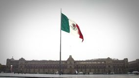 View of The National Palace of Mexico in a rainy day, the flag flutters. Is one of the most important historic buildings in Mexico. Mexico City, MEX. 27/09/18 stock video