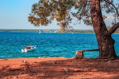 View on adriatic sea with a little boat in foreground. stock photo