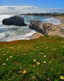 View of the Natural Bridge in the Natural Bridges National Park in Santa Cruz. The natural bridge has been hewed out of the rocky coast by the action of waves Stock Photos