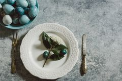 Naturally dyed Easter eggs, on te table setting Stock Images