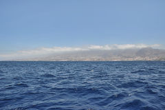 View from a nautical vessel towards Costa Adeje, Tenerife, Canary Islands. The most popular resort in Tenerife, is Costa Adeje, with lots of activities, boat Royalty Free Stock Images