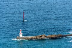 View on a navigational light at the harbor entrance royalty free stock photo
