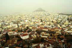 View of the neighborhoods of Anafiotika and Plaka in a winter day, from the Acropolis of Athens Greece Stock Image