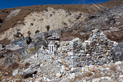 View of Nepalese Settlement with unfinished Stone House. Made according to traditional manual work technology without using tools and cement in Mountain Area of royalty free stock photography