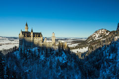 View of Neuschwanstein Castle in winter from Queen Mary`s Bridge. With snow Stock Photos