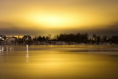 View of Neva River at evening. View of Neva River at evening when the clouds reflected the light from the city lights on the outskirts of St. Petersburg, Russia Stock Photography