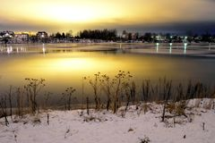 View of Neva River at evening. View of Neva River at evening when the clouds reflected the light from the city lights on the outskirts of St. Petersburg, Russia Stock Images
