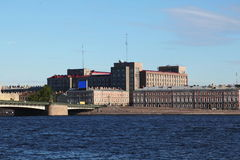 View from the Neva river on the Foundry bridge and the building in the style of constructivism - the Big House. Royalty Free Stock Image