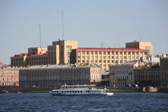 View from the Neva river on the Foundry bridge and the building in the style of constructivism - the Big House. Stock Photo