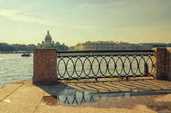 A view of the Neva river and a fragment of the lattice on the University embankment. Stock Images