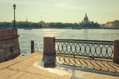 A view of the Neva river and a fragment of the lattice on the University embankment. Stock Image