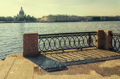 A view of the Neva river and a fragment of the lattice on the University embankment. Royalty Free Stock Photography