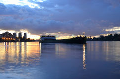 View of Neva River and river cargo ship at sunset. Stock Images