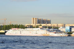 View of Neva River and river cruise ship. ST.PETERSBURG, RUSSIA - MAY 19, 2012: View of river Neva on the outskirts of St. Petersburg at sunny spring evening Stock Photography