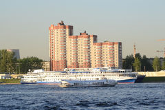 View of Neva River and river cruise ship. ST.PETERSBURG, RUSSIA - MAY 19, 2012: View of river Neva on the outskirts of St. Petersburg at sunny spring evening Royalty Free Stock Images