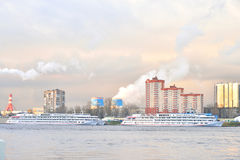 View of Neva River and river cruise ship. ST.PETERSBURG, RUSSSIA - 21 APRIL 2016: View of river Neva on the outskirts of St. Petersburg at cloud spring evening Stock Images